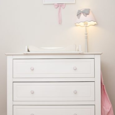 White furniture with cute spotted knobs