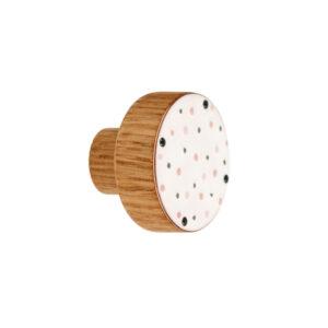 Różowe kropeczki na białym tle - emaliowana gałka meblowa do pokoju dziecięcego | DOT Manufacture