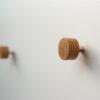 Minimalistyczne gałki do mebli - TECHNIC mini - na białym meblu